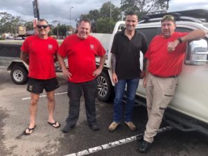 Animal Evac volunteers standing in a car park by a four wheel drive